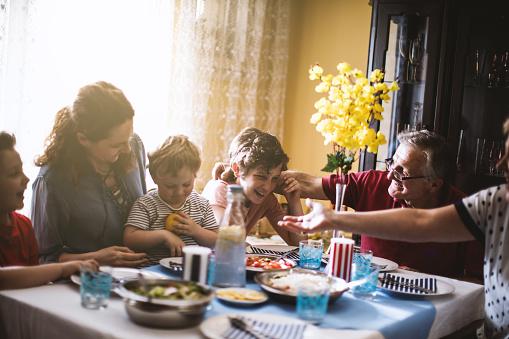 Multi generation family dinner