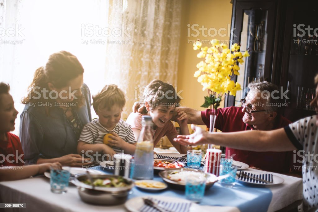 Multi generation family dinner stock photo