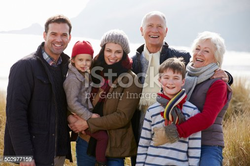 istock Multi Generation Family In Sand Dunes On Winter Beach 502977159
