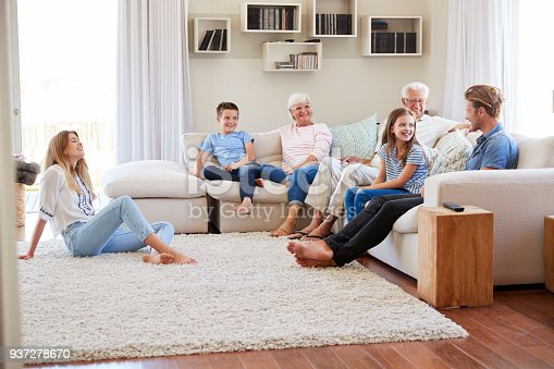 istock Multi Generation Family Relaxing On Sofa At Home Together 937278670