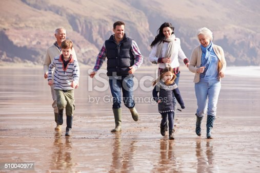 istock Multi Generation Family Running On Winter Beach 510040977