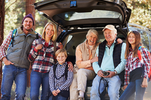 istock Multi generation family standing by a car before forest hike 518185936