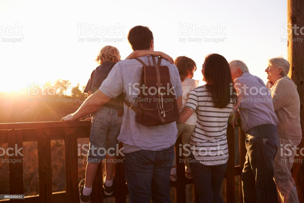 Multi Generation Family Standing On Outdoor Observation Deck stock photo