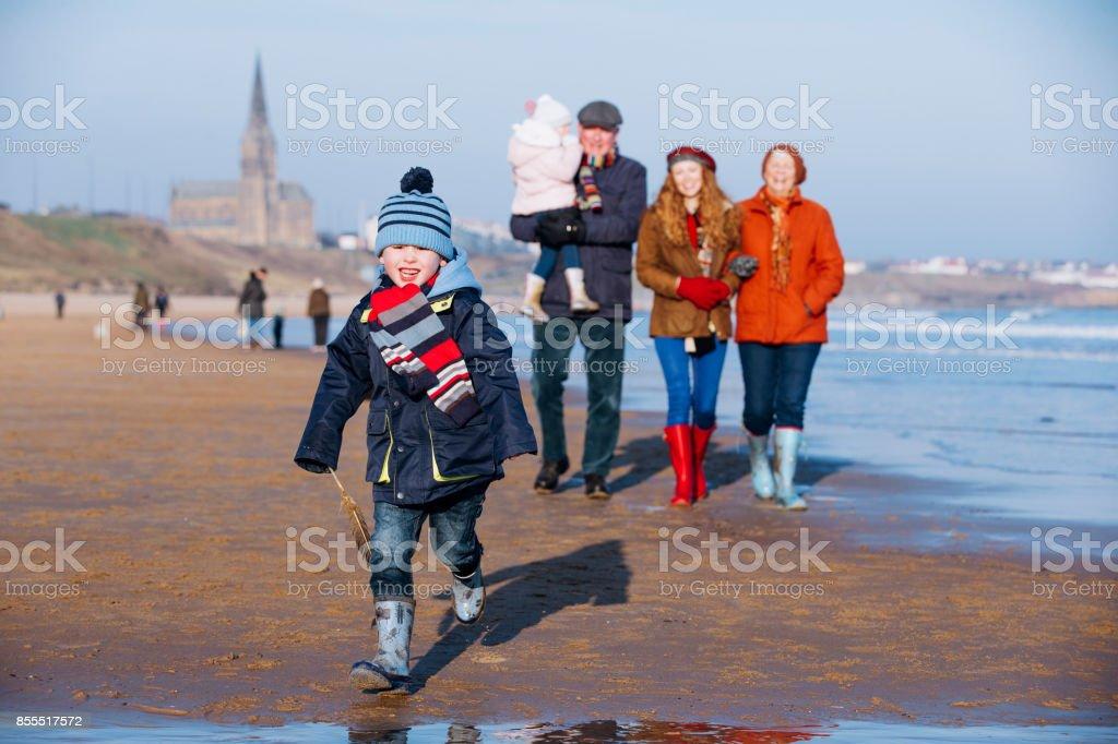 Multi- Generation Family Taking a Walk Along the Beach stock photo
