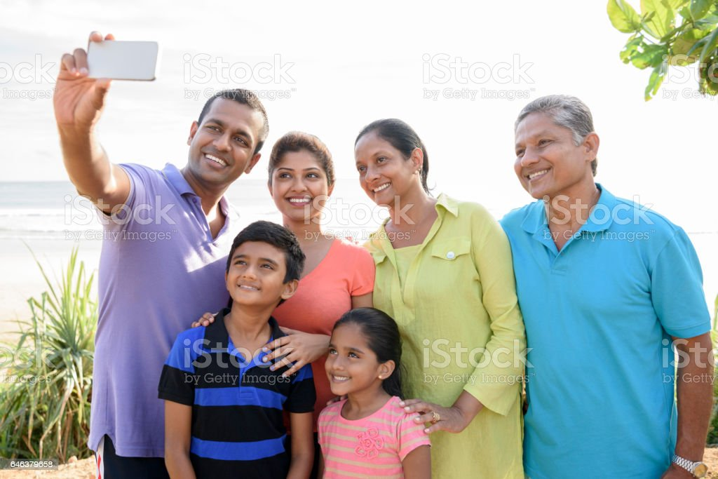 Multi generation family taking selfie with phone stock photo