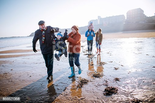 istock Multi- Generation Family Walking Along the Beach 855521358