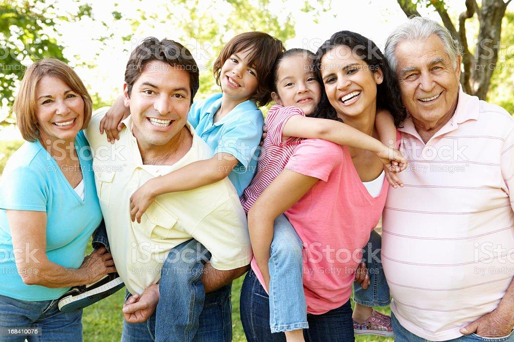 Multi Generation Hispanic Family Having Fun In Park stock photo