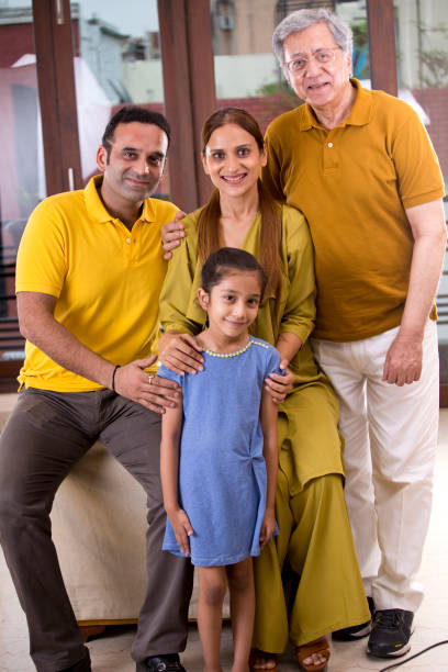 Multi generation Indian family at home stock photo