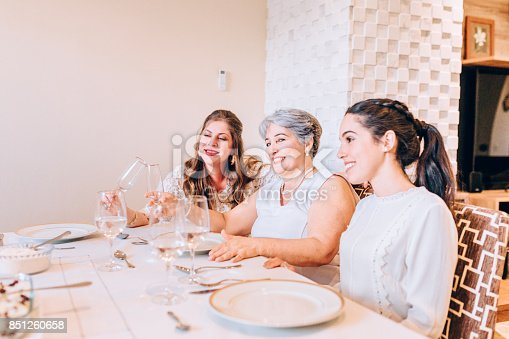 1035768506 istock photo Multi generation women at family lunch 851260658