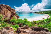 Multi panorama view of most spectacular tropical beach Grande Anse on La Digue Island, Seychelles. Vacation holidays lifestyle concept.