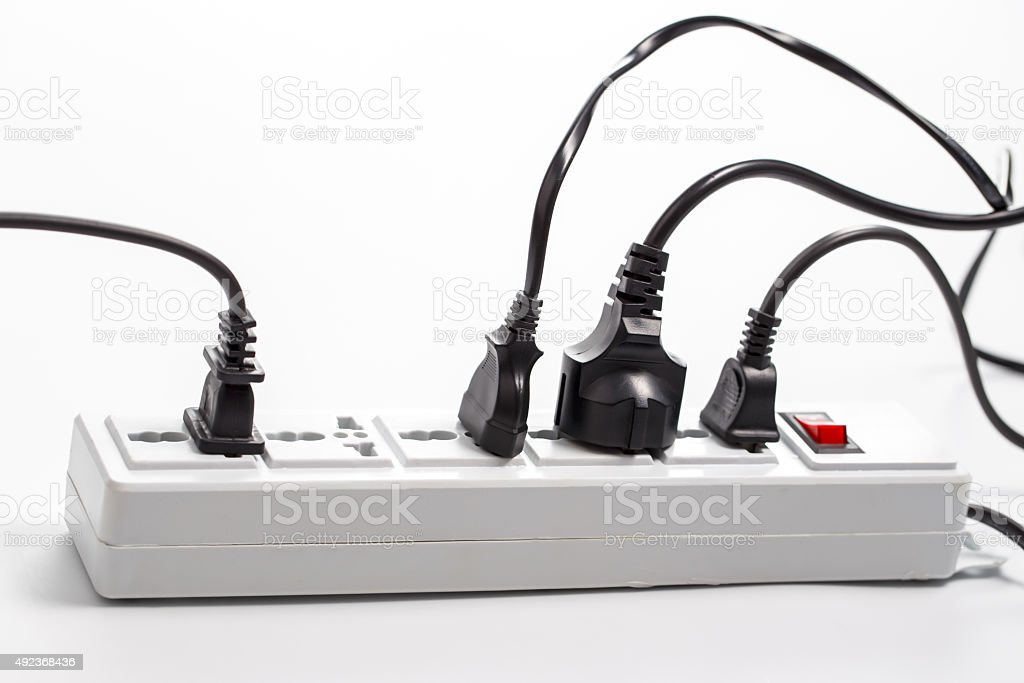 Multi plug electrical power strip isolated on a white background stock photo