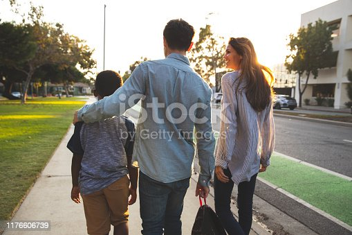 Multi racial family with adoptive children spending time together at the park