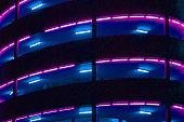 Abstract lighting on the multi storeys of a car park viewed from street level in Bristol. This is at Cabot Circus on the eastern edge of the city.