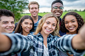 istock Multi_ethnic Teenagers Taking a Self Portrait stock photo 1184216653