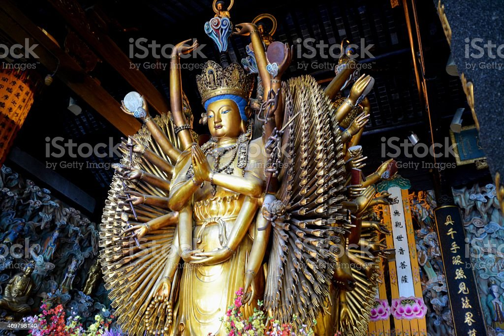 Multi-armed Shiva statue at Longhua temple, Shanghai stock photo