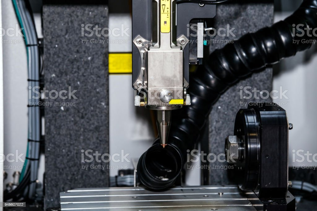Multi-axis laser processing workcell stock photo