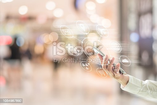 846708102 istock photo Multichannel marketing via cloud computing network on mobile smartphone app for digital shopping people lifestyle 1054987892