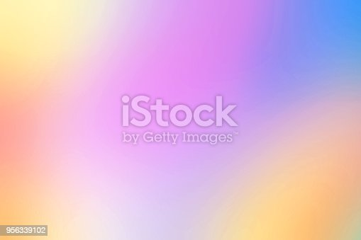istock Multicolor  Abstract blurred gradient mesh background in bright rainbow colors. Colorful Hologram  fairy backdrop. Soft colored Pastel clouds and sky