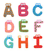 Multicolor alphabet fridge magnet letters (A-I) isolated on white background