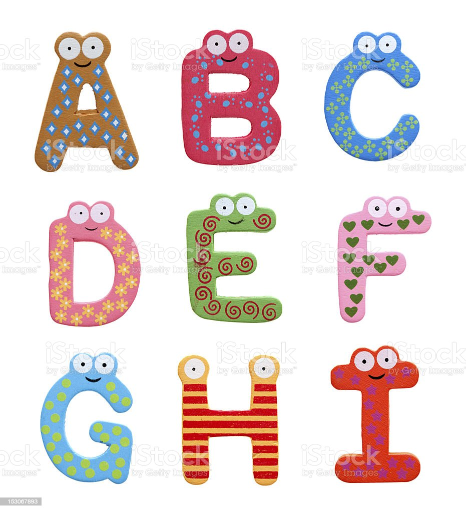 Multicolor alphabet fridge magnet letters isolated on white background stock photo