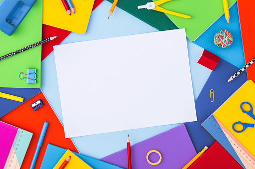 Multicolor background with school supplies and copy space. Top view.