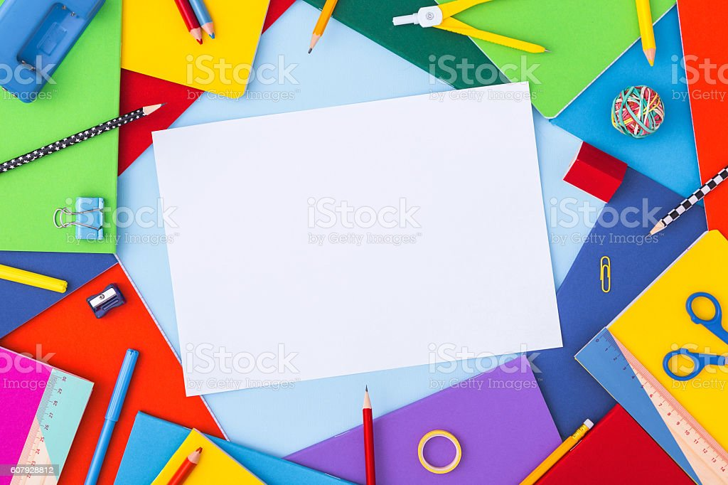 Multicolor background with school supplies and copy space. Top view. stock photo