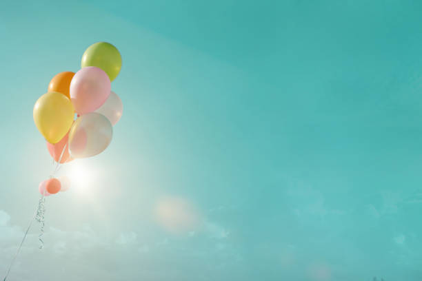 multicolor balloons with a retro filter effect, stock photo