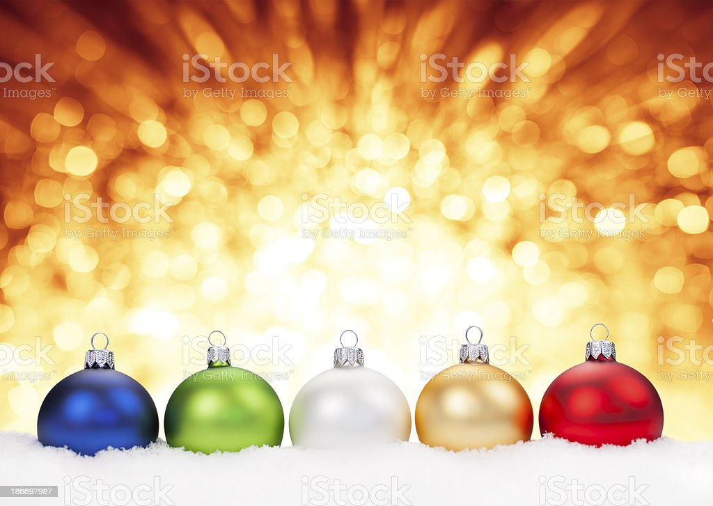 Multicolor Baubles lying on Snow royalty-free stock photo