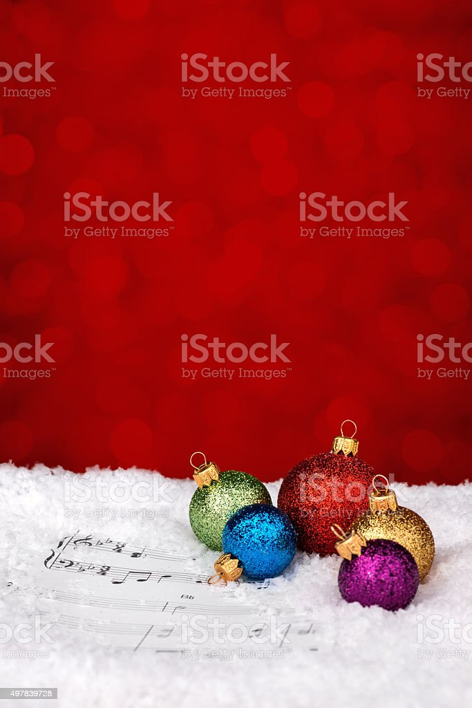 Multicolor baubles on sheet notes stock photo