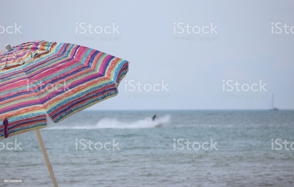 Multicolor beach umbrella stock photo