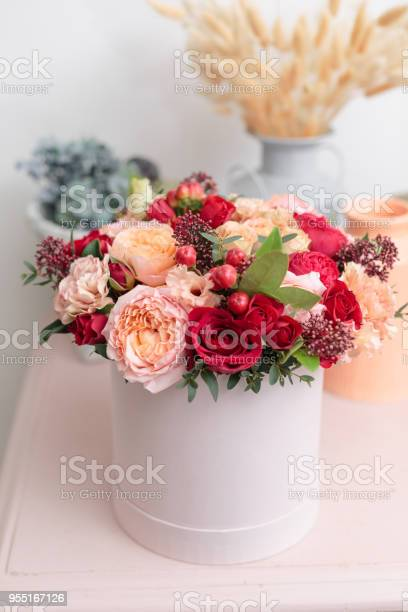 Multicolor bouquet of beautiful flowers on wooden table floristry picture id955167126?b=1&k=6&m=955167126&s=612x612&h=4iri oenlgm4xwxsxljznzwexg9d1qh1ldjghkos7rg=