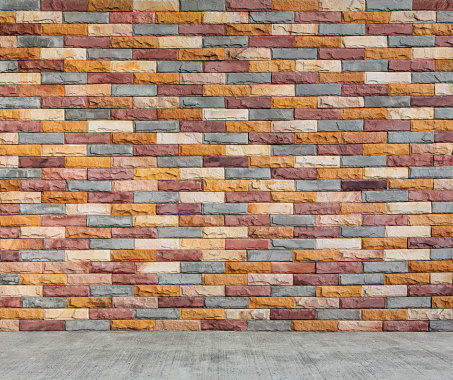 multicolor brick wall and cement floor as texture and background