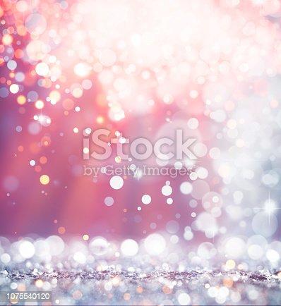 621592540istockphoto Multicolor christmas defocused lights background 1075540120