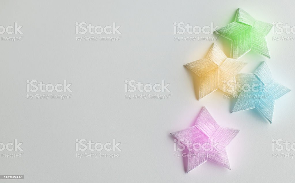 Multi-color Christmas star isolated on white background with copy space stock photo
