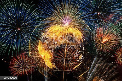 istock Multicolor Firework Celebration over the Part of Abstract planet earth particle background, Independence day concept 1007750006