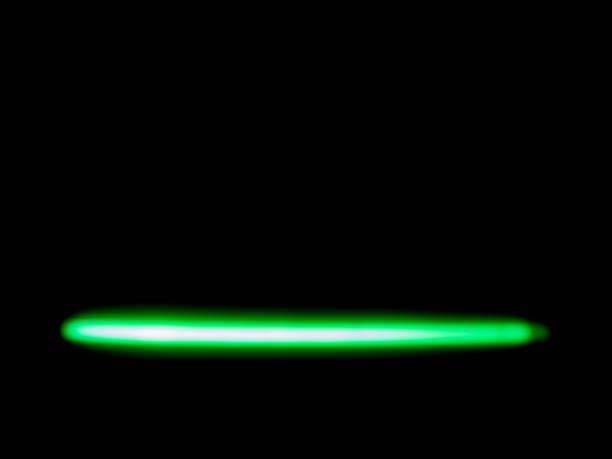 tubes fluorescents multicolors sur fond noir - fluorescent light stock pictures, royalty-free photos & images