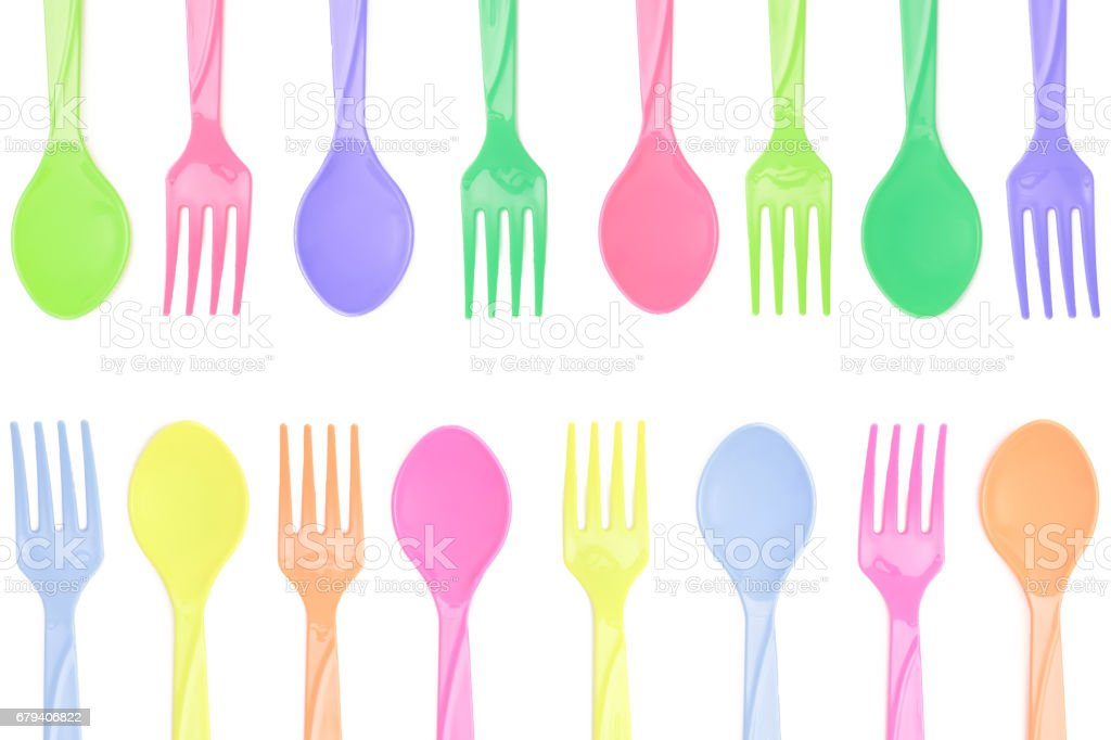 Multicolor fork and spoon on white background royalty-free stock photo