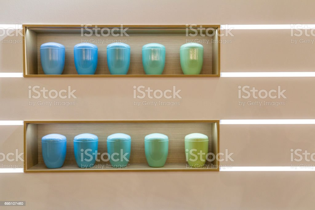 multicolor funeral urn stock photo