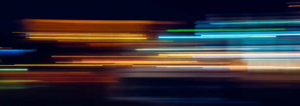 multicolor light trails - motion stock pictures, royalty-free photos & images