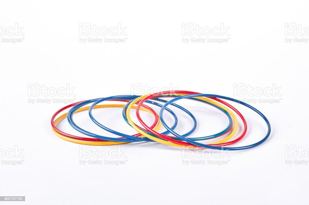Multicolor plastic bangles on white background. stock photo