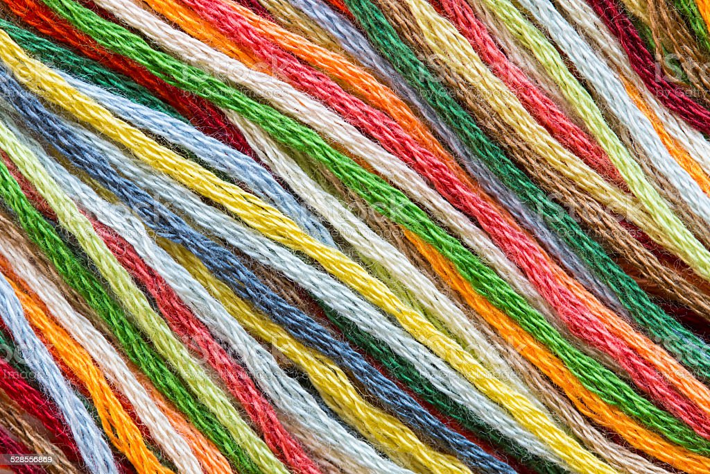 Multicolor sewing threads texture stock photo