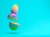 青色の背景の 3 D レンダリングの多色スライス パイナップル