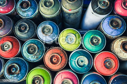 Spray cans photographed from above, you see all the colors usable.