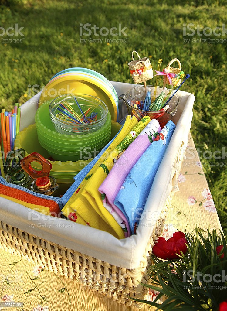 Multicolor summer picnic accessories in a basket royalty-free stock photo