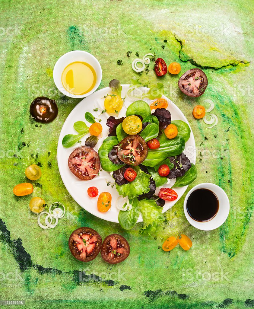 Multicolor Tomatoes salad with dressing oil and vinegar stock photo