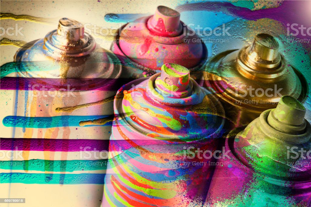 Multi-colored aerosol paints on a dirty gray background . – Foto