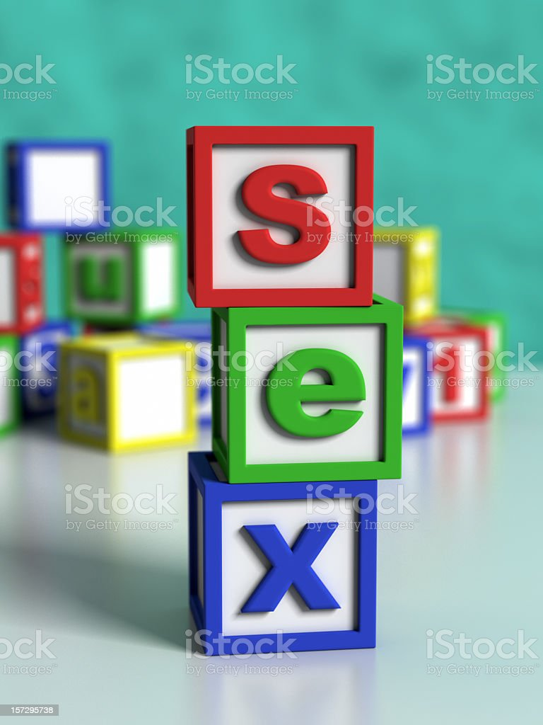 Multicolored and lettered building blocks spell out sex  stock photo