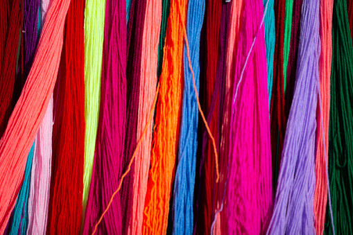 Multicolored background made of many colored threads.