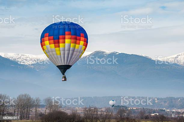 Multicolored Balloon In The Blue Sky Stock Photo - Download Image Now