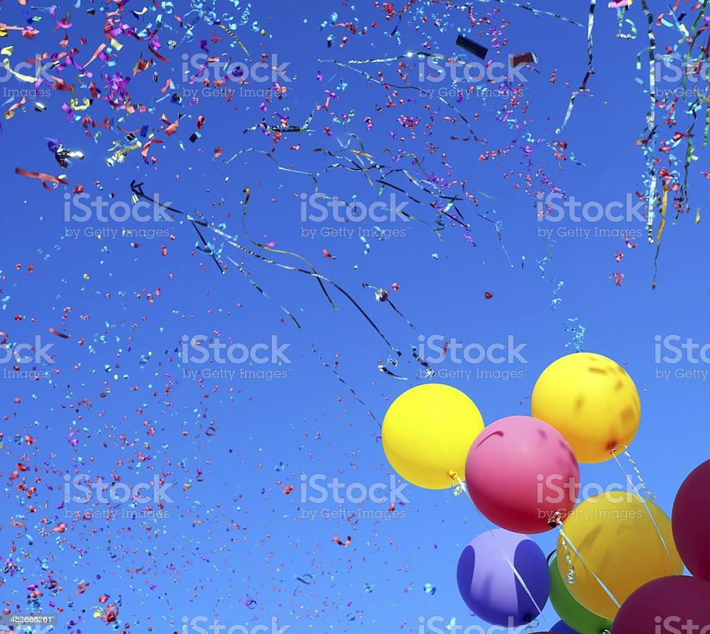 multicolored balloons and confetti stock photo
